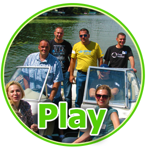 Play - photo of group of 6 on a boat on a lake